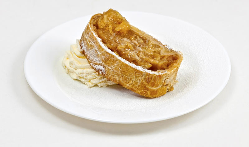 Viennese Apple Strudel. Apple strudel (German: Apfelstrudel) is a traditional Viennese strudel, a popular pastry in Austria and in many countries in Europe that stock photography