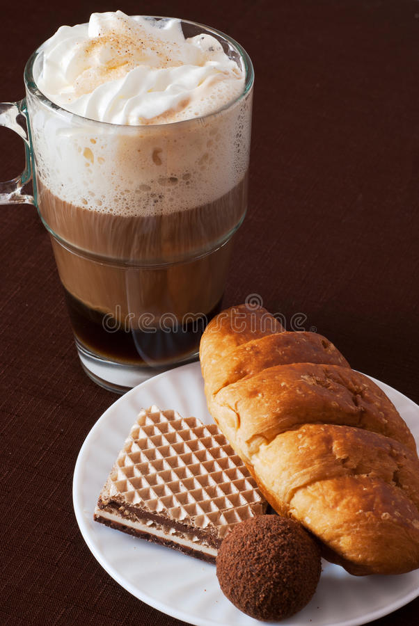 Viennese coffee with desserts stock photos