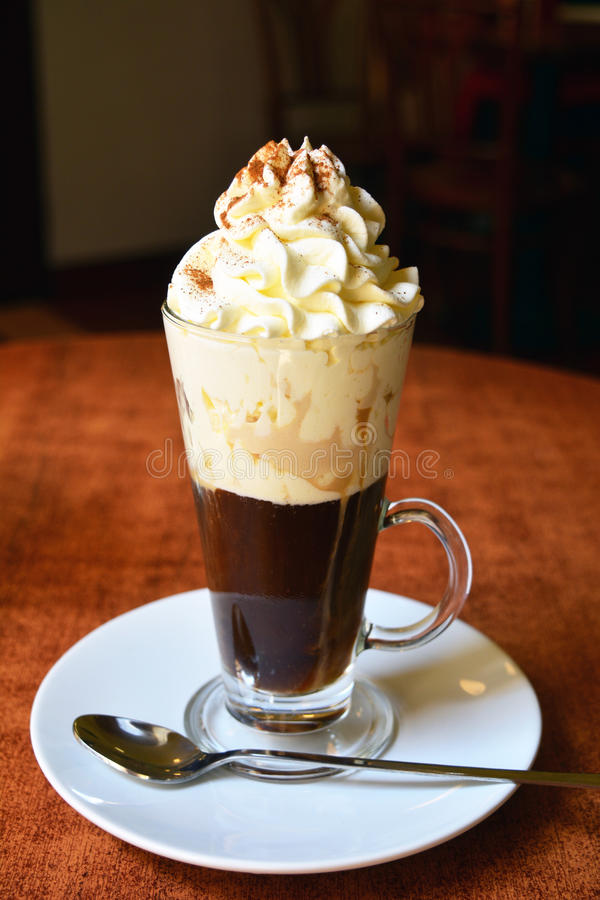Viennese Coffee In Glass Cup With Whipped Cream stock images