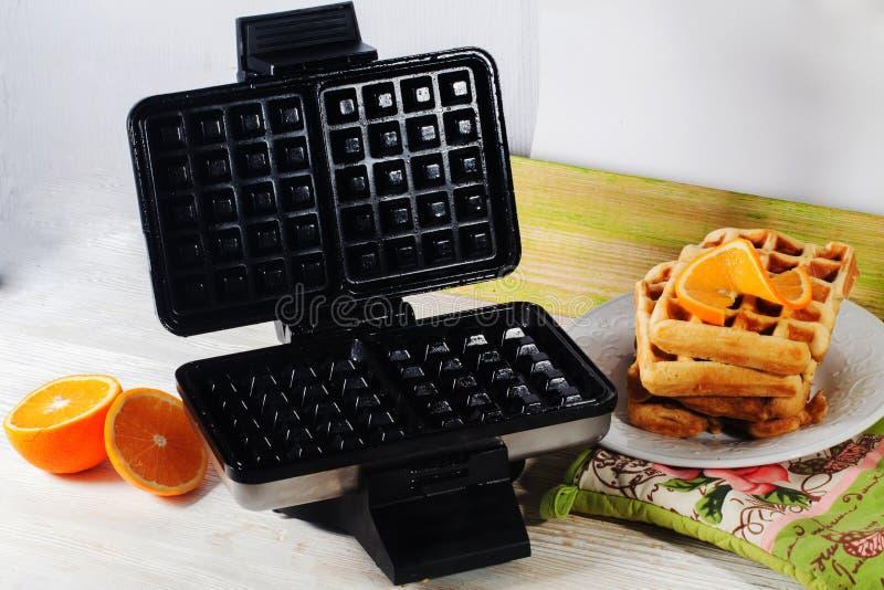 Viennese waffles waffle iron pile of orange Belgian Prague royalty free stock image