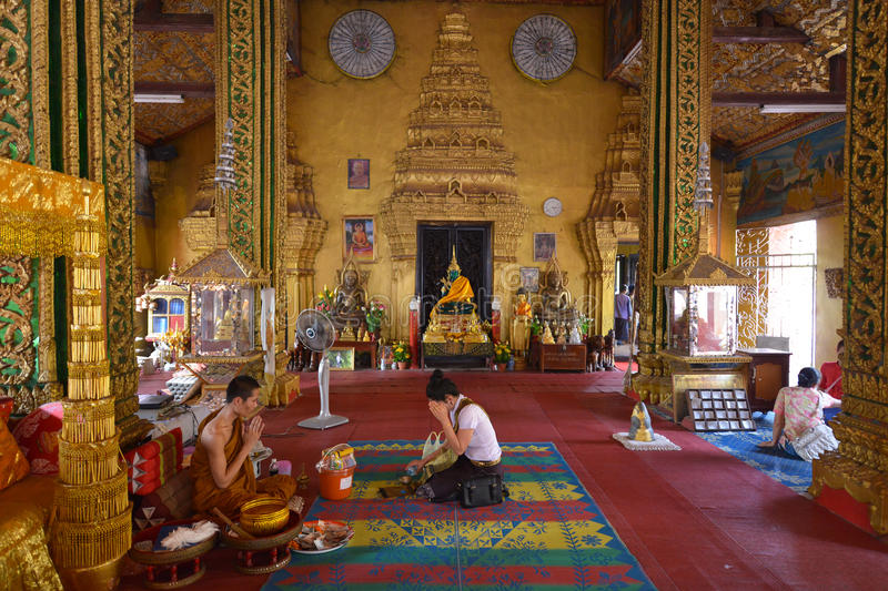 Vientiane, Laos. March 5: Unidentified people making an offering at Wat Si Muang on March 5, 2014 in stock image