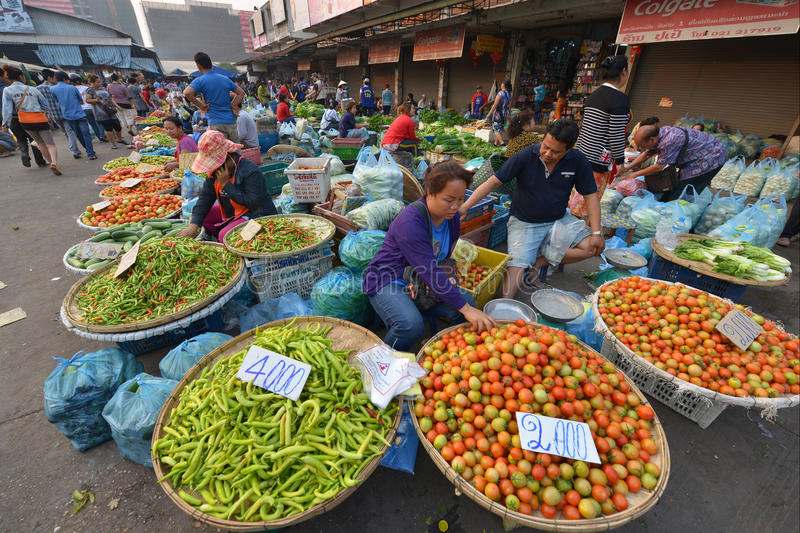 Vientiane, Laos. March 5: Unidentified people selling vegetables at Talat Sao on March 5, 2014 in royalty free stock photography