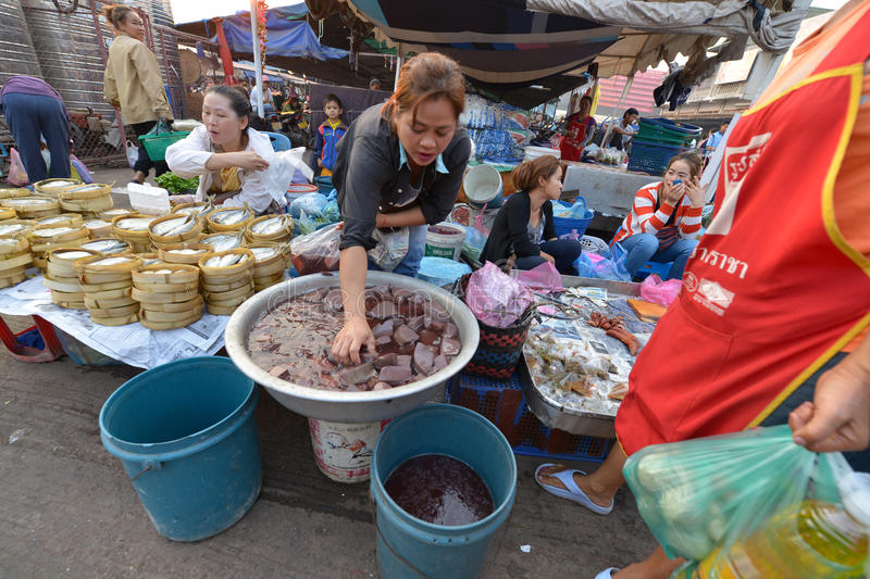 Vientiane, Laos. March 5: Unidentified people selling vegetables at Talat Sao on March 5, 2014 in royalty free stock photo