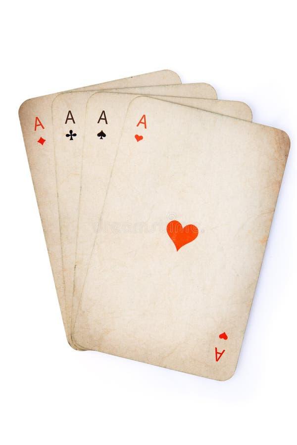 Vier azen oude kaarten stock afbeeldingen