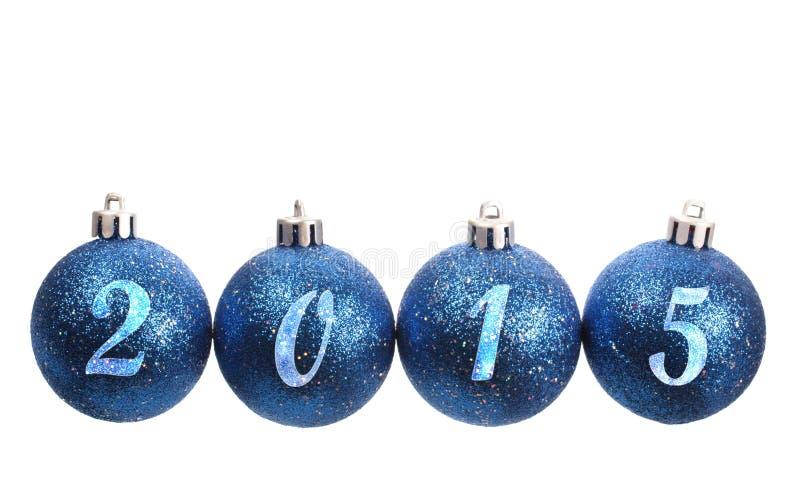 Vier blauwe die spangled Kerstmisballen in het jaar 2015 worden geschikt stock foto