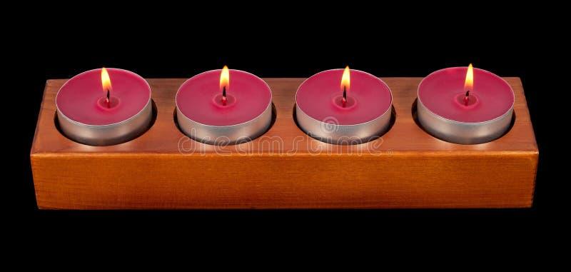 Vier brennende Kerzen lizenzfreie stockfotos