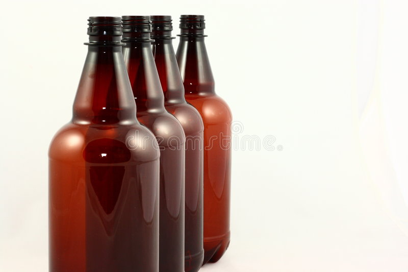 Vier Brown-Flaschen lizenzfreie stockbilder