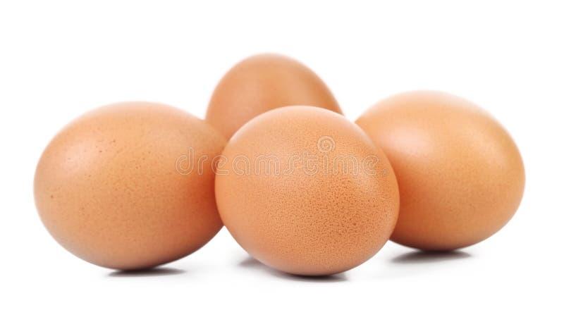 Vier bruine eieren royalty-vrije stock foto's