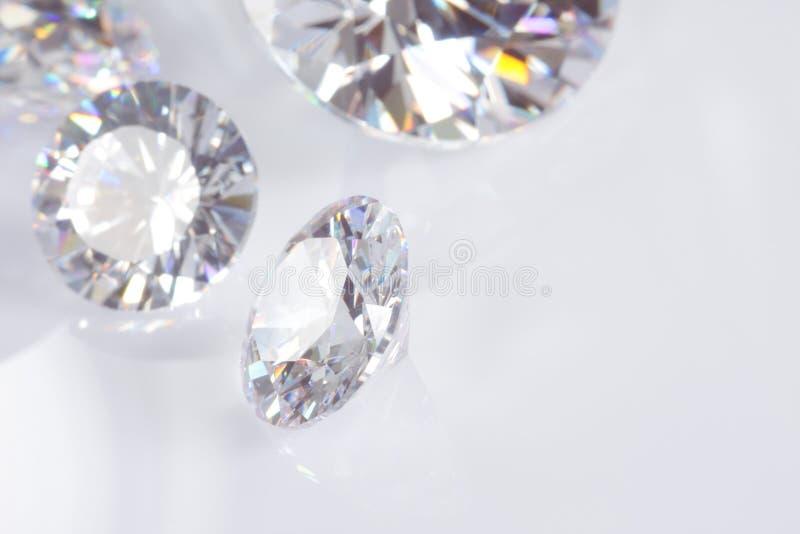 Vier Diamanten mit Exemplar-Platz lizenzfreie stockfotos