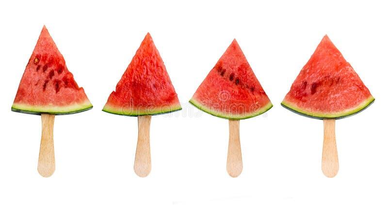 Vier die ijslollys van de watermeloenplak op het witte, verse concept van het de zomerfruit worden geïsoleerd royalty-vrije stock foto