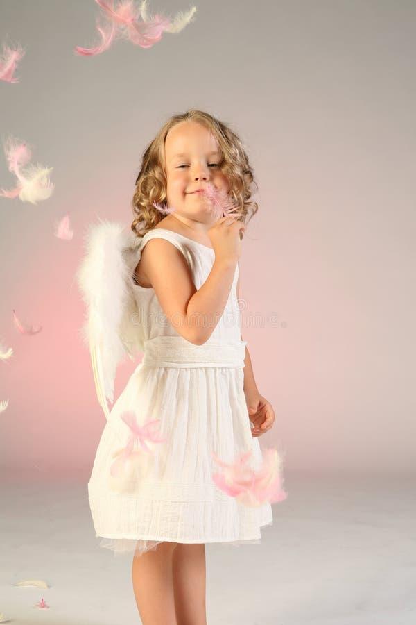 Vier Einjahresmädchen Als Engel Lizenzfreie Stockfotografie