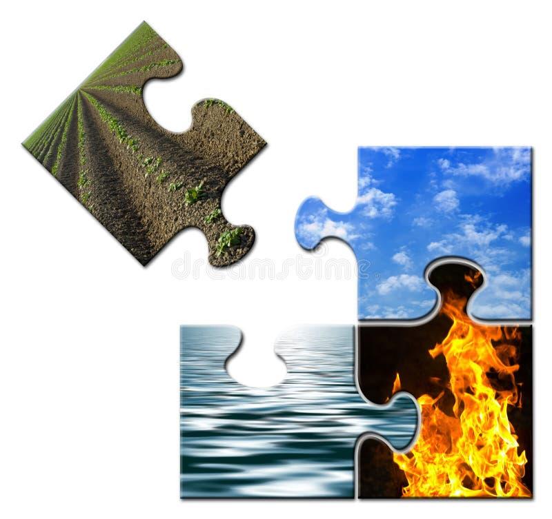 Vier Elemente in einem Puzzlespiel - Erde auseinander stockfoto