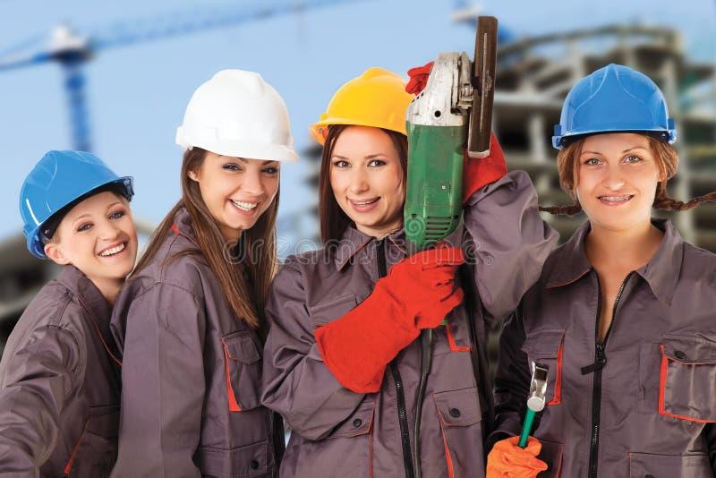 Vier Frauenbauarbeiter stockfotografie