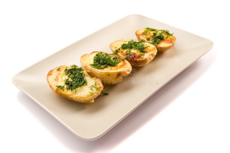Vier gebackene Kartoffeln stockfotografie