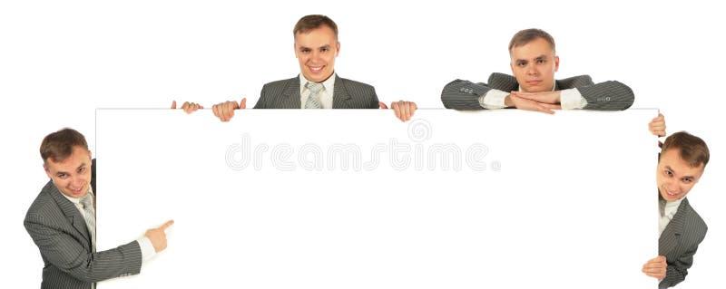 Vier Geschäftsmannerscheinen an Bord lizenzfreies stockbild