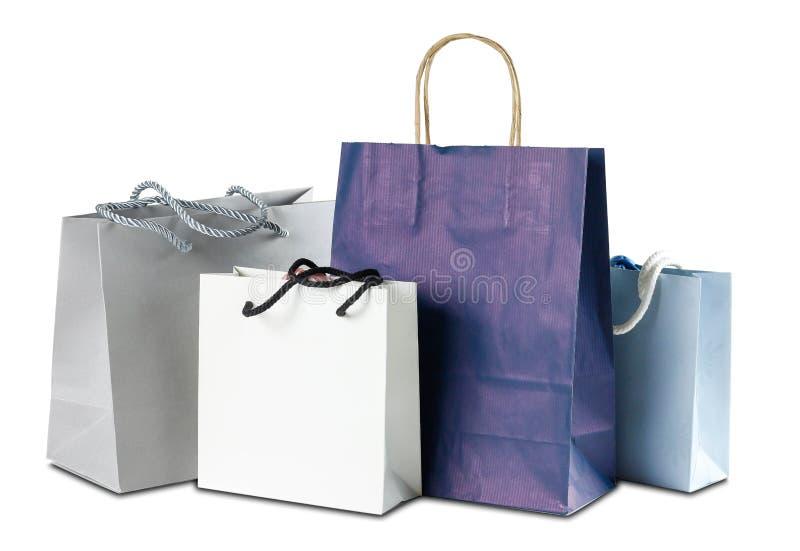 Vier Geschenk farbige Papiertüten auf weißem Hintergrund Abschluss oben lizenzfreie stockfotos