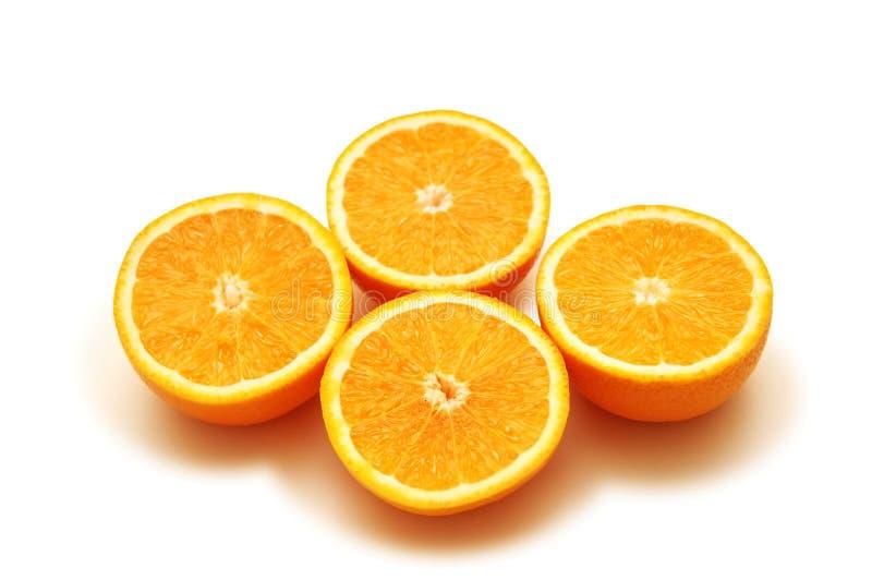 Vier gesneden sinaasappelen stock foto's