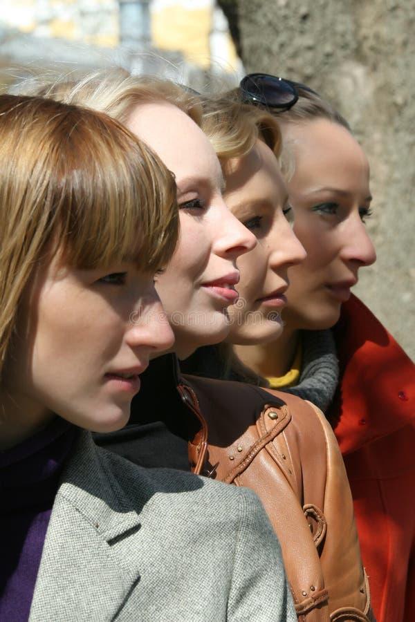 Vier gezichten stock afbeeldingen