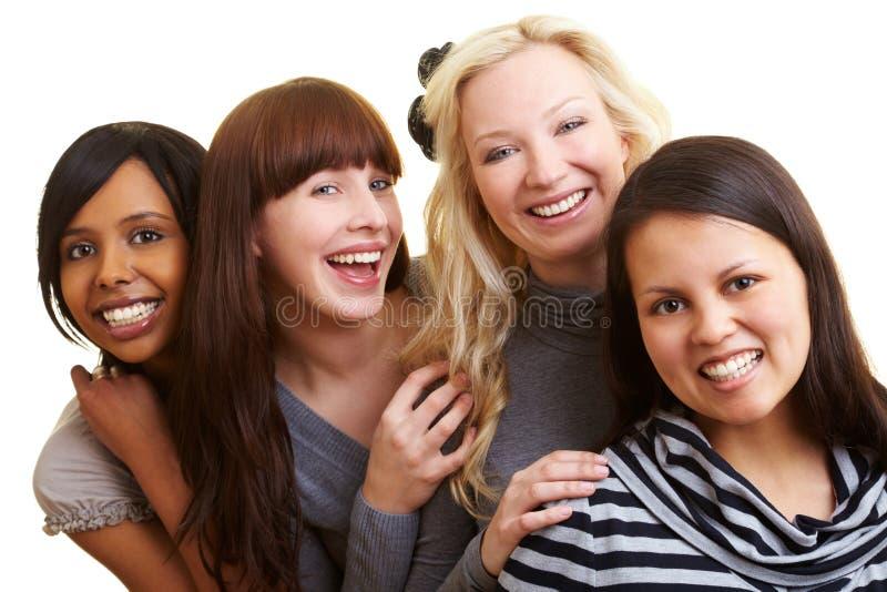 Vier glimlachende jonge vrouwen royalty-vrije stock afbeelding