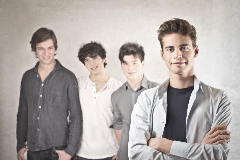 Vier glimlachende Vrienden royalty-vrije stock afbeelding