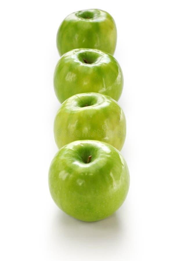 Vier groene appelen royalty-vrije stock afbeeldingen