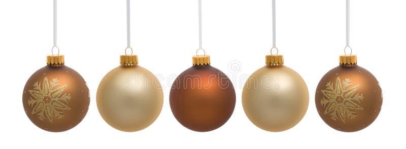 Vier hängende Weihnachtsverzierungen stockfotos