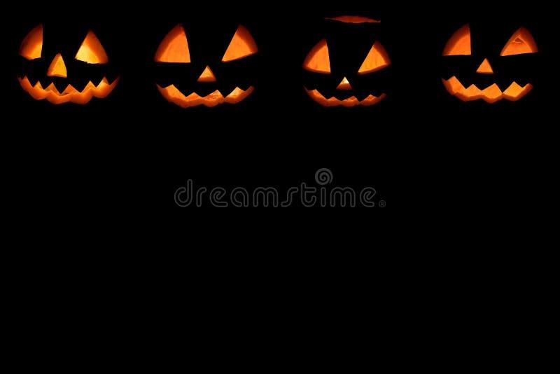 Vier Halloween-pompoenenachtergrond royalty-vrije stock afbeelding
