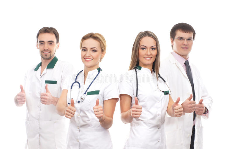 Vier het jonge medische arbeiders omhoog beduimelt houden royalty-vrije stock fotografie