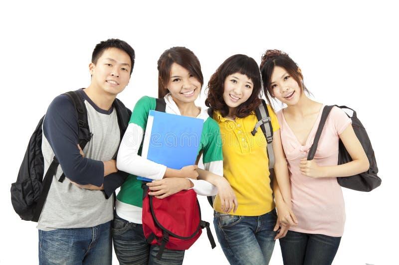 Vier jonge gelukkige studenten royalty-vrije stock afbeelding