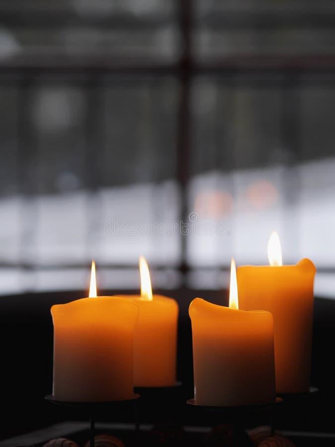Vier kaarsen het branden royalty-vrije stock foto
