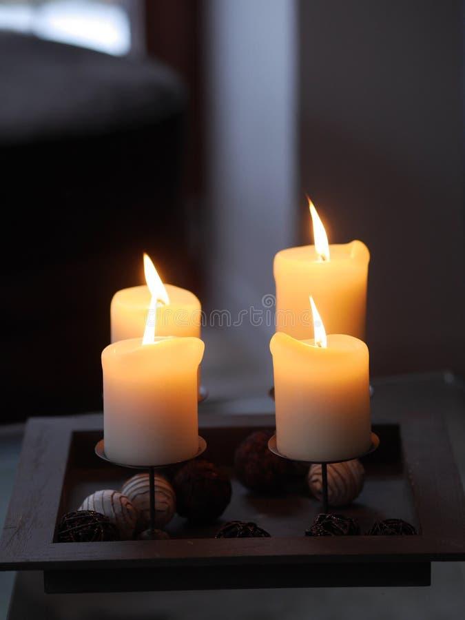 Vier kaarsen het branden royalty-vrije stock afbeelding