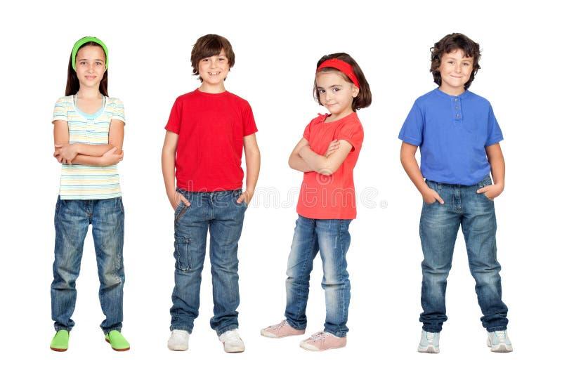 Vier kinderen, klein team stock afbeeldingen