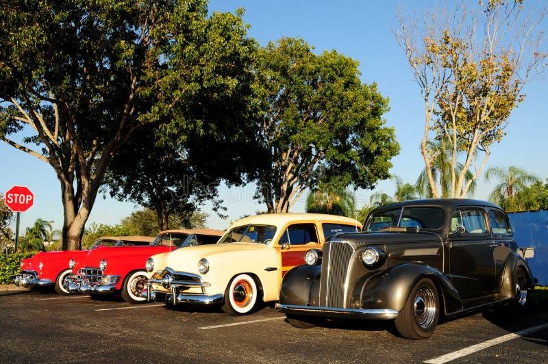 Vier klassieke voertuigen stock afbeeldingen
