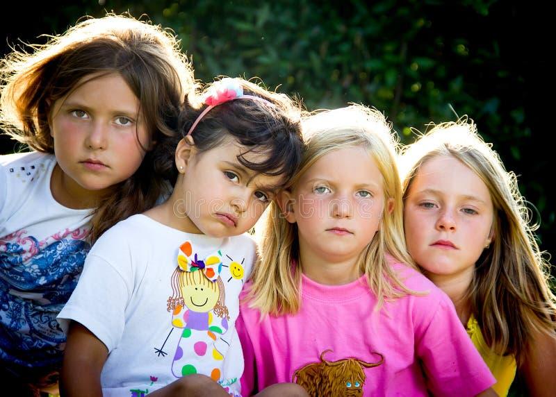 Vier kleine Mädchen stockbilder