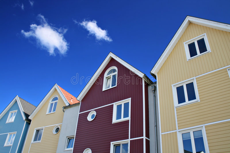 Vier kleurrijke huizen stock foto