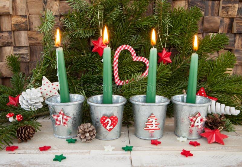 Vier Komstkaarsen stock afbeelding