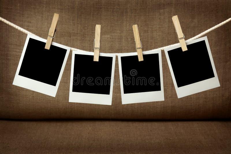 Vier leere sofortige Fotos stockfotografie