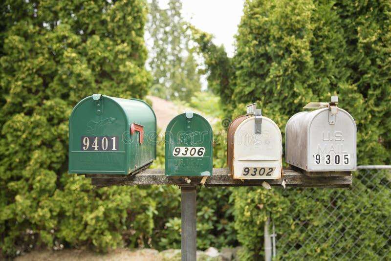 Vier Mailboxes lizenzfreie stockfotos
