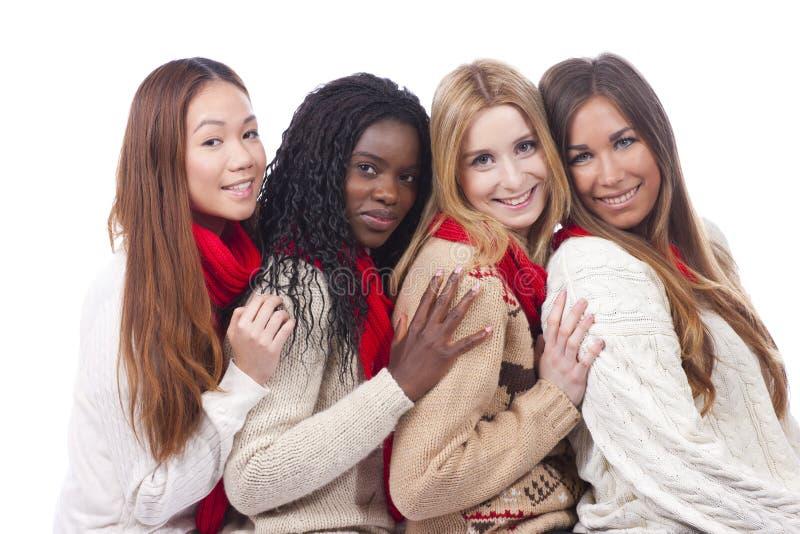 Vier meisjes met verschillende afleiding stock afbeeldingen