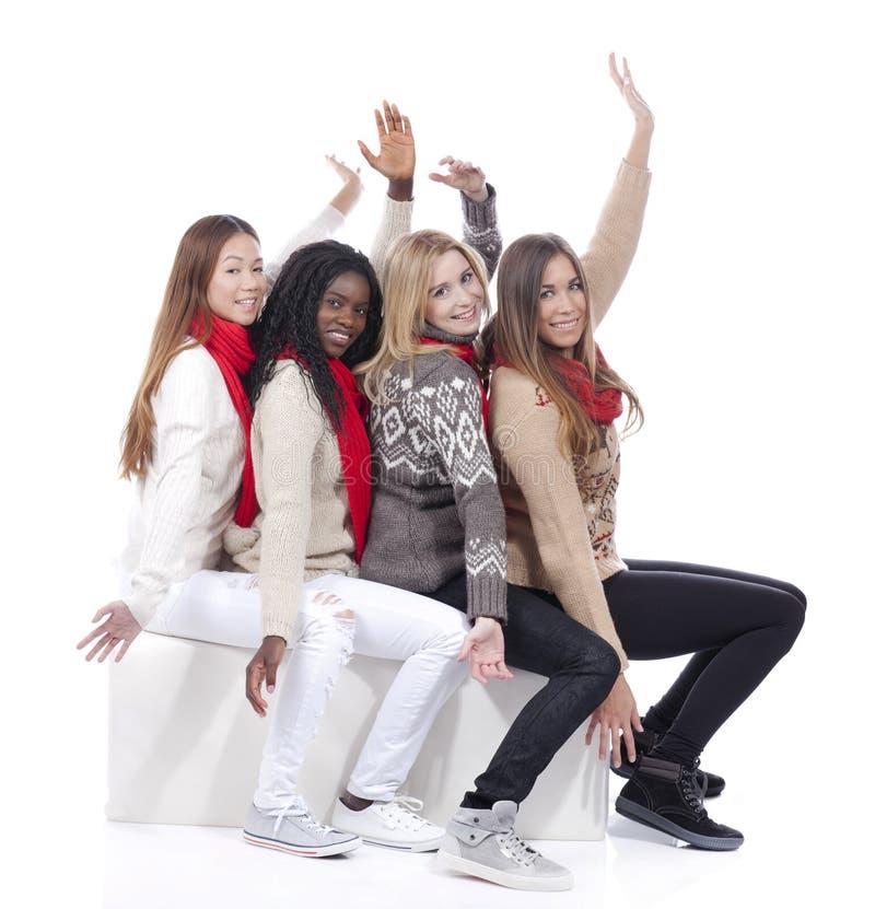 Vier meisjes met verschillende afleiding met omhoog handen royalty-vrije stock afbeeldingen