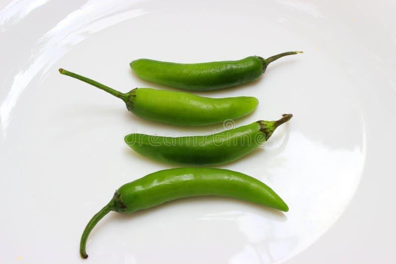 Vier mexikanische würzige chilis auf Draufsicht stockfotos