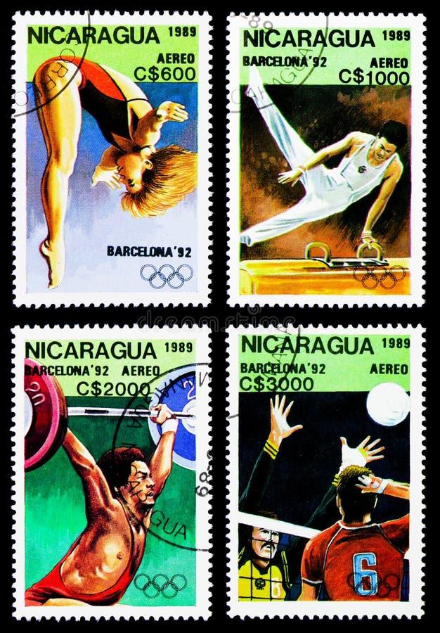 Vier postzegels die in Nicaragua van de Olympische Spelen 1992 worden gedrukt - Barcelona serie, circa 1989 stock foto's