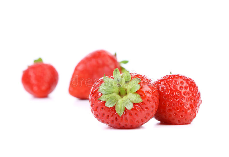 Vier Rijpe Aardbeien. stock afbeelding