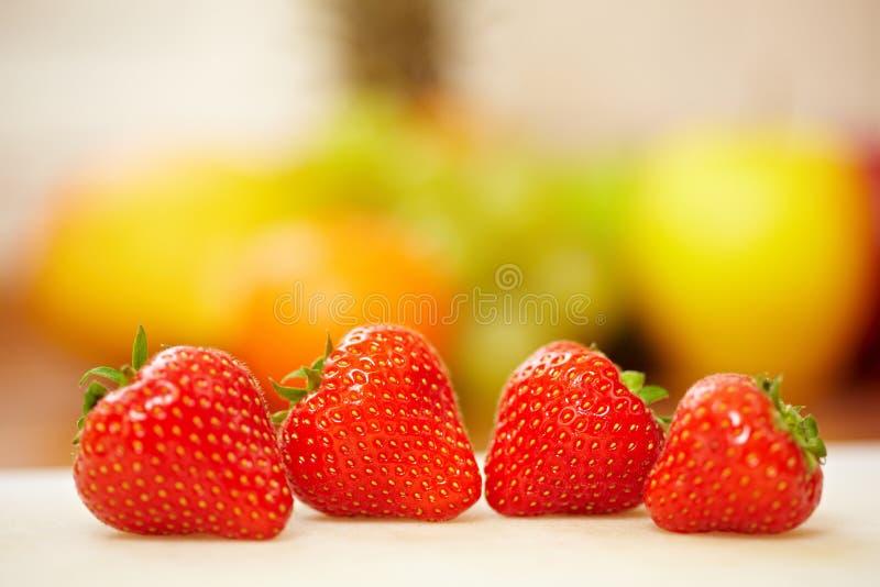 Vier rode aardbeien stock afbeelding