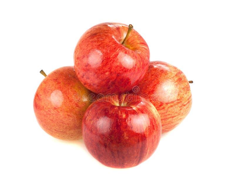Vier rode rijpe appelen op een witte achtergrond stock afbeeldingen