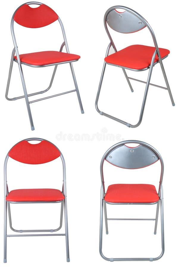 Vier rode vouwende stoelen royalty-vrije stock afbeelding