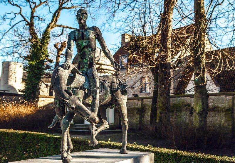 Vier ruiters van Apocalypsstandbeeld in Brugge, België stock foto's