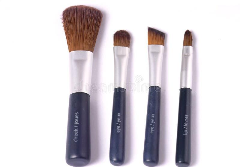 Vier schoonheidsborstels stock afbeeldingen