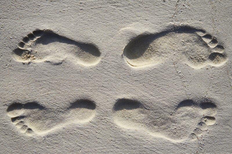 Vier Schritte auf einem Strand stockfotografie