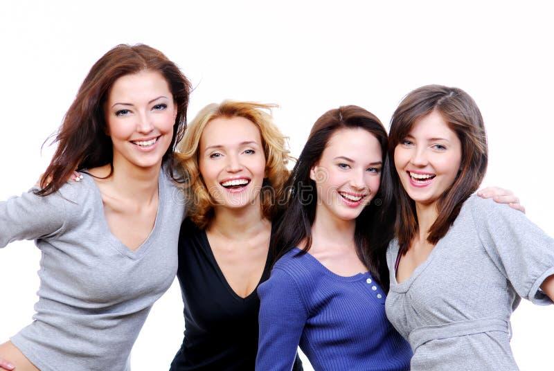 Vier sexy, mooie jonge gelukkige vrouwen stock afbeeldingen